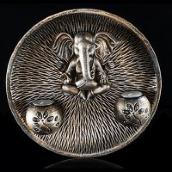 Round Ganesha wall plate with 2 tea light candles