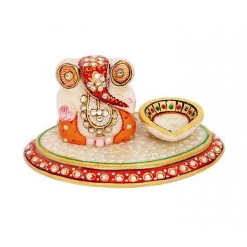 Ganesh ji  on Oval Chowki with Diya