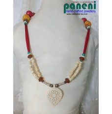 BONE AND HORN BEADS SET WITH LEAF PENDANT